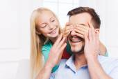 Little girl covering eyes of her cheerful father — Stockfoto