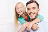 Little girl embracing her father — Stock Photo