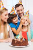 Family of four celebrating birthday — Stock Photo