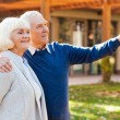 Senior couple pointing away — Stock Photo #55329255
