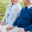 Senior couple holding hands — Stock Photo #55329563