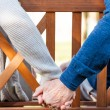 Senior couple holding hands — Stock Photo #55329809