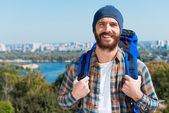 Man carrying backpack — Stock Photo