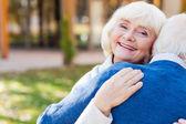 Happy senior woman embracing her husband — Stock Photo