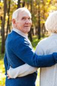 Happy senior man walking by park with his wife — Fotografia Stock