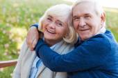 Happy senior couple bonding to each other — Stockfoto