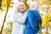 Happy senior couple bonding to each other — Stock Photo