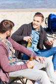 Young men drinking beer and talking — Stock Photo