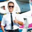 Pilot in uniform showing his thumb up — Stock Photo #55975511