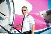 Confident male pilot in uniform — Stock Photo