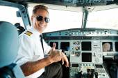 Pilot showing his thumb up — Stock Photo