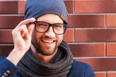 Man in smart casual wear adjusting his eyeglasses — Stock Photo