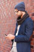 Man in smart casual wear holding mobile phone — Stock Photo
