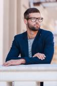 Young man in eyeglasses and smart casual wear — Stock Photo