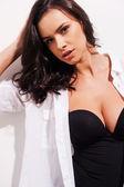 Beautiful young woman in unbuttoned shirt — Stock Photo
