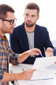 Confident business people discussing project. — Stock Photo