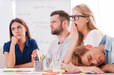 Business people on boring presentation.