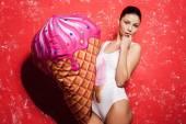 Woman holding huge fake ice cream — Stock Photo