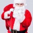 Santa Claus holding his finger on lips — Stock Photo #57614189