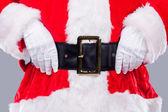 Santa Claus adjusting his belt — Stock Photo