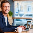 Man working on laptop in cafe — Stock Photo #57857217