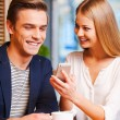 Woman showing mobile phone to boyfriend — Stock Photo #57857263