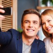 Couple making selfie by smart phone — Stock Photo #57857281