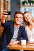 Couple making selfie by smart phone — Stock Photo
