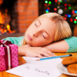 Little girl sleeping near Christmas tree — Stock Photo #58008821