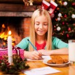 Little girl writing letter to Santa Claus — Stock Photo #58008877