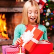 Little girl opening Christmas gift box — Stock Photo #58008933