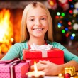 Girl embracing gift box — Foto Stock #58008947