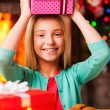 Little girl carrying Christmas gift box — Stock Photo #58008977