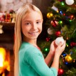 Little girl decorating Christmas Tree — Stock Photo #58008985