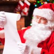 Santa Claus reading letter — Stock Photo #58009019