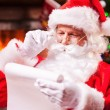 Santa Claus reading a letter — Stock Photo #58009033