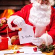 Santa Claus reading letters — Stock Photo #58009193
