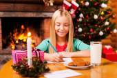 Little girl writing letter to Santa Claus — Stock Photo