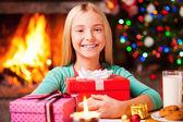 Girl embracing gift box — Stockfoto