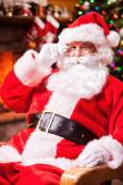 Santa Claus sitting at his chair — Stock Photo
