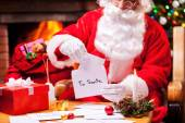 Santa Claus reading letters — Stock Photo