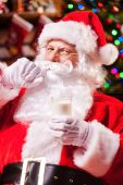 Santa Claus holding glass with milk — Stock Photo