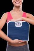 Woman holding weight scale — Stock Photo