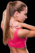 Young woman touching her neck — Stock Photo