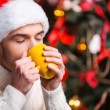 Man in Santa hat drinking hot drink — Stock Photo #59199707