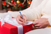 Man writing Christmas letter — Stock Photo