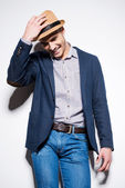 Man in smart casual wear adjusting fedora — Stock Photo