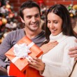 Woman opening a gift box on Christmas — Stock Photo #59294703