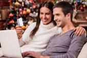 Couple buying online on  Christmas — Stock Photo