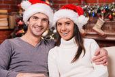 Young loving couple on Christmas — Stock Photo